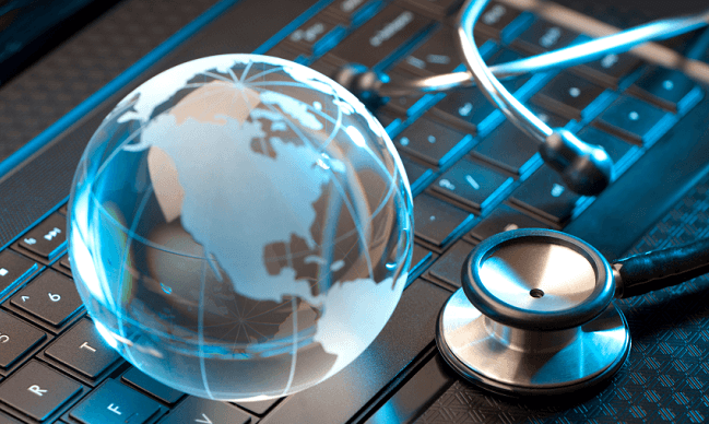a stethoscope atop a laptop